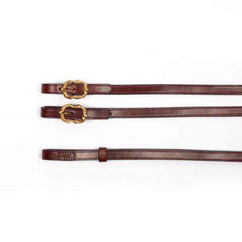 Barocke Zügel aus braunem Leder mit goldenen Cortesia Schnallen bei Picadera